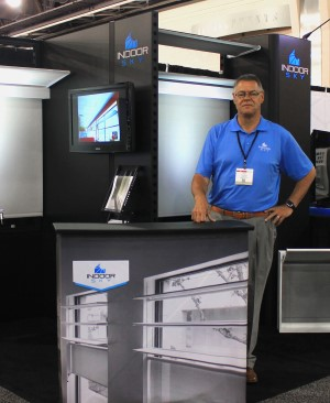 Paul Moulton stands beside the Indoor Sky Skyliter tradeshow display.