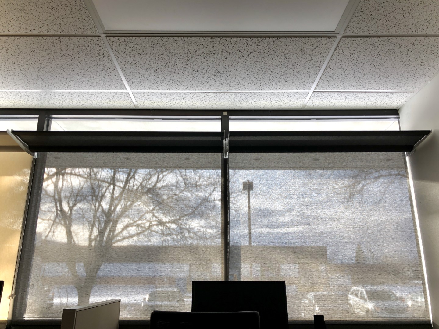 Office with translucent shades. Daylight is significantly reduced, but light shelves still reflect daylight across the ceiling.